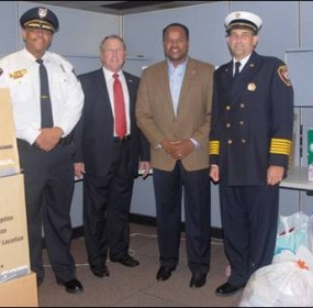Surrounded by donations from Missouri City residents for families impacted by the Texas wildfires are from left, Police Chief Joel Fitzgerald, Mayor Allen Owen, State Rep. Ron Reynolds and Fire Chief Russell Sander.